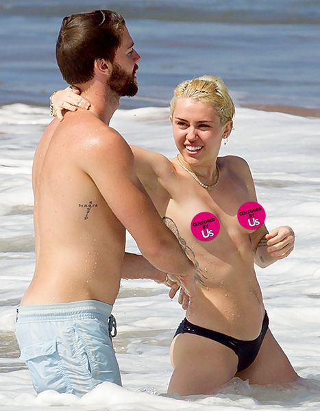 Miley Cyrus topless with Patrick Schwarzenegger