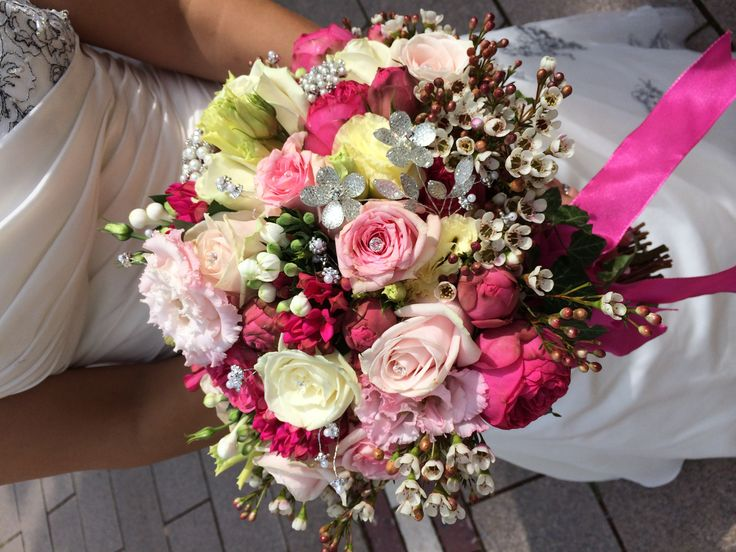 Special bouquet for a very special bride. Fuchsia pink and cream with all the bling ;) Chanan's Floral Events