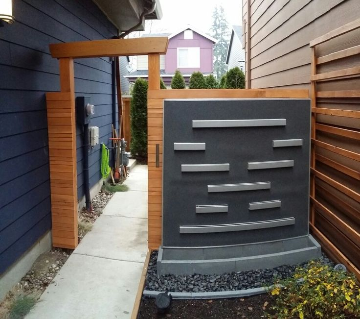 Horizontal board fence with arbor and sliding gate, 8'x30' layered trellis, planet box with automatic watering system and a 5' tall tiered water wall all built from scratch and it only took me the better part of a year to build it all ;)