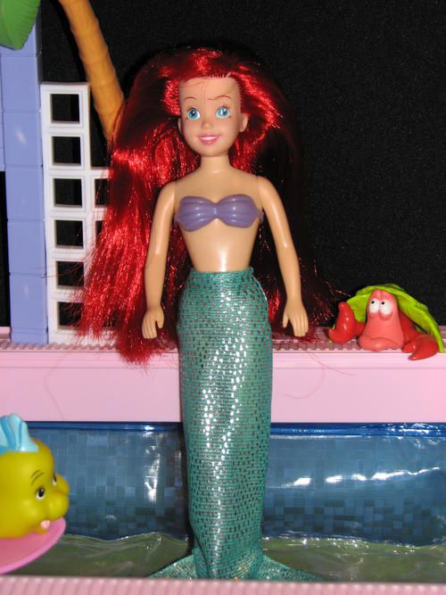 Little Mermaid doll. I had 2. One in the princess gown and the other in full mermaid gear and I used to put them in regular clothes and pretend they were twins dating my 2 Jordan Knight dolls.