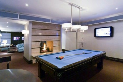 Cool recreation room with the fireplace between the two spaces