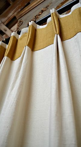 Nice take on a traditional pinch pleated #drapery with the #banding and double tacking for visual interest at the top. #windowtreatments