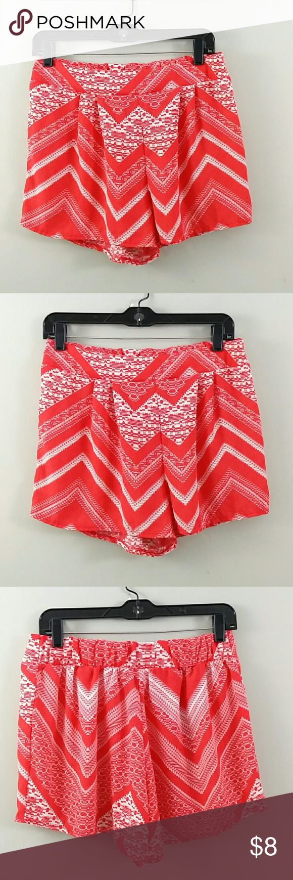 "Body Central Women's L Orange Chevron Short You are looking at a pre-owned women's Body Central Made in the USA orange/coral short, 109% polyester, size Large Length~12"" Inseam~2.5"" Waist~28"" Elastic Please look at pictures and ask questions before buying. Thanks for looking. Body Central Shorts"