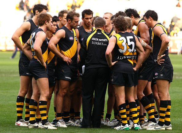 Damien Hardwick Photos - Damien Hardwick coach of the Tigers addresses his players after their narrow defeat in the round eight AFL match between the Richmond Tigers and the Hawthorn Hawks at Melbourne Cricket Ground on May 16, 2010 in Melbourne, Australia. - AFL Rd 8 - Tigers v Hawks