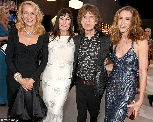 Say cheese: (L-R)Jerry Hall, Anjelica Huston, Sir Mick Jagger Kelly Lynch