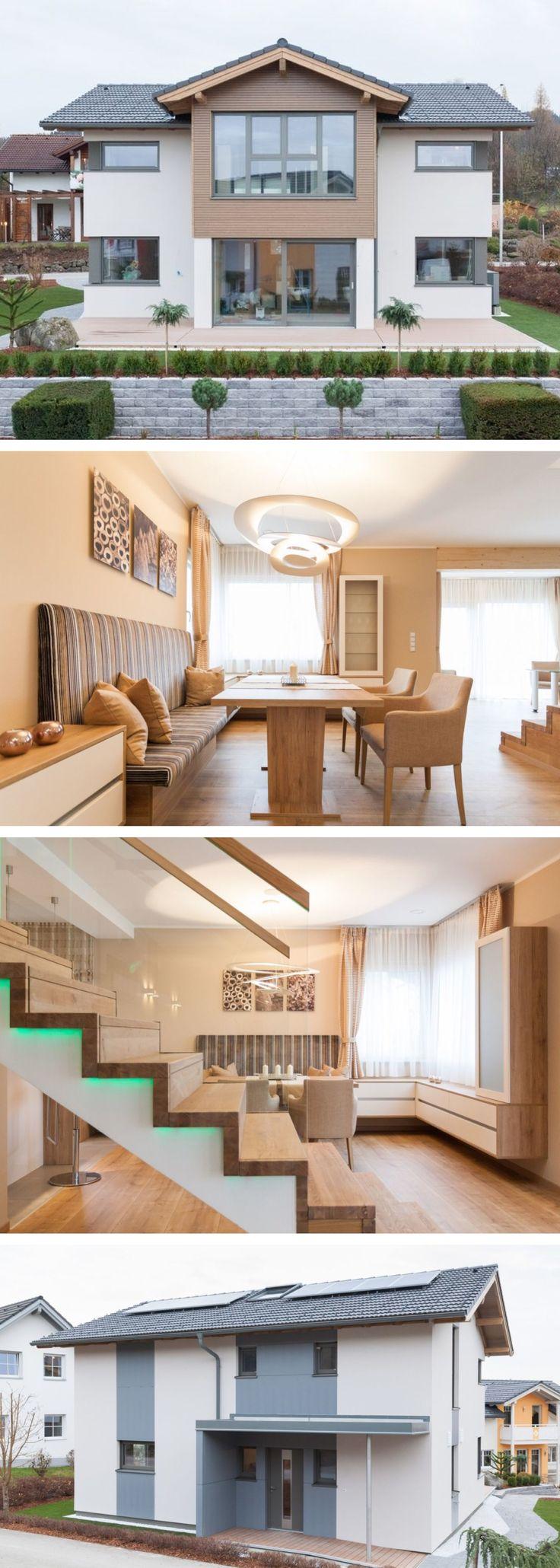 Fertighaus im modernen Alpenstil - Haus Eugendorf Classic 157 S HARTL HAUS - Einfamilienhaus mit Satteldach Grundriss modern offener Wohnbereich mit Küche - HausbauDirekt.de