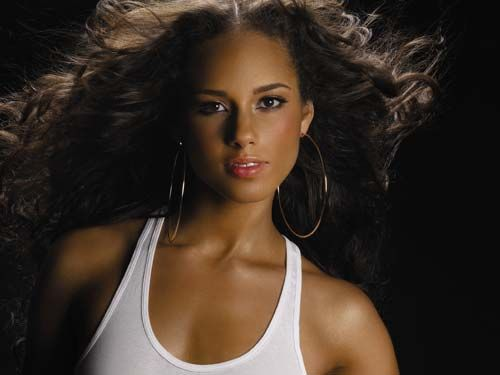 Alicia Keys - he wishes I had her ... voice.