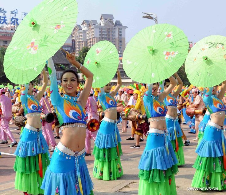 Girls of Dai ethnic group perform umbrella dance during a cultural demonstration to celebrate the New Year of Dai ethnic group in Jinghong City, Dai Autonomous Prefecture of Xishuangbanna, Yunnan Province, April 14, 2015. Over 5,000 local people took part in the demonstration, presenting traditional arts and dances http://www.chinatraveltourismnews.com/2015/04/new-year-of-dai-ethnic-group-celebrated.html