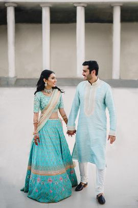 and pastel blue kurta for him