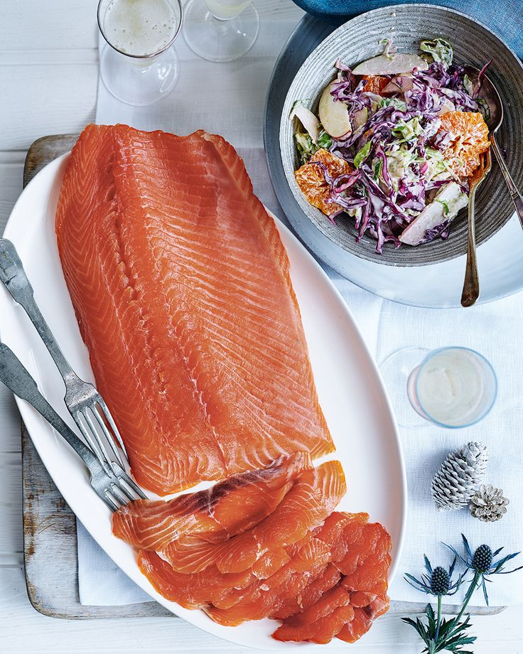 Nathan Outlaw cures salmon with brandy in this Christmas-appropriate recipe. Serve with the seasonal slaw for some welcomed crunch – together it's t