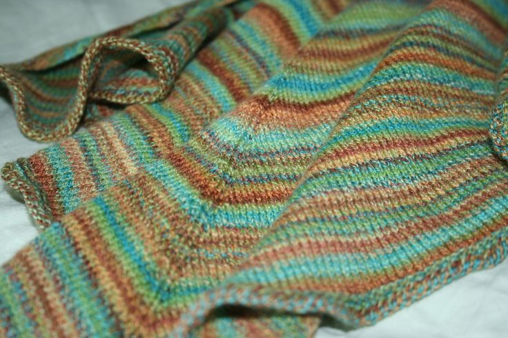 Look no further than the Forester Knitted Shawl if you are in search of free shawl knitting patterns. This turquoise, green, and brown treasure looks like it was knit by fairies themselves and delivered to your doorstep.