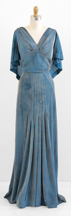 1930s velvet dress with cape-like sleeves and gathers on the skirt.