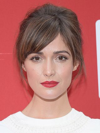 Inimitably chic Rose always works a polished 'do, and this glossy side fringe is no different. Worn with red lipstick and minimal make-up, the blunt, tapered cut looks sexy against an elegant up-'do.