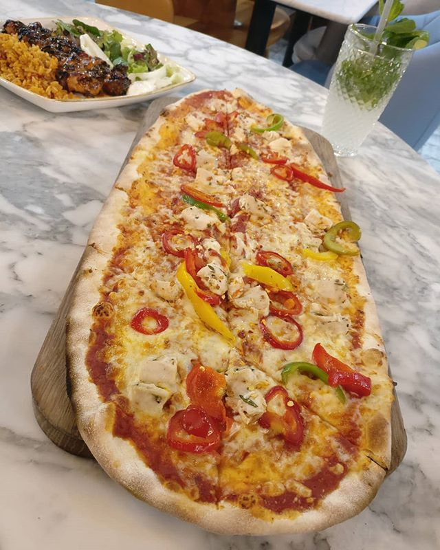 How Grande Does This Pizza From Marco And Carl Bradford