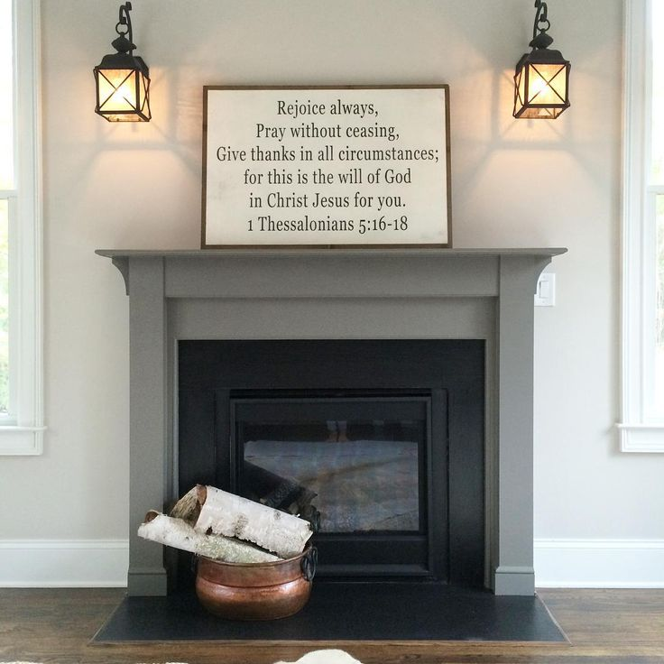 sherwin williams agreeable gray on wall - Black Fireplace Mantels