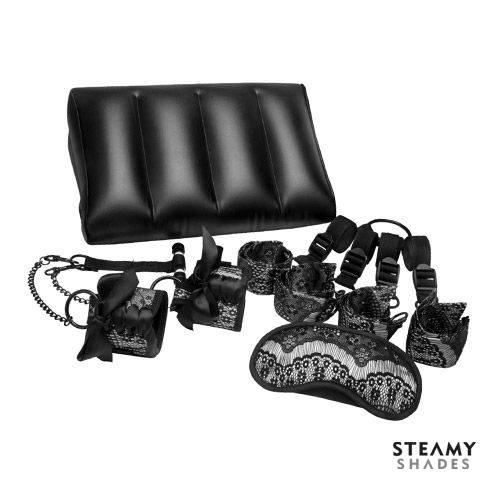 STEAMY SHADES POSITIONING SET  The Steamy Shades Positioning Set come with a Eyemask, Satin Ties Bed Restraint Kit, Door Jam Closet Cuffs and Inflatable Position Wedge, the door Jam Closet Cuffs allow for vertical intimate play and features elegant lace detail, perfect for beginner couples…….