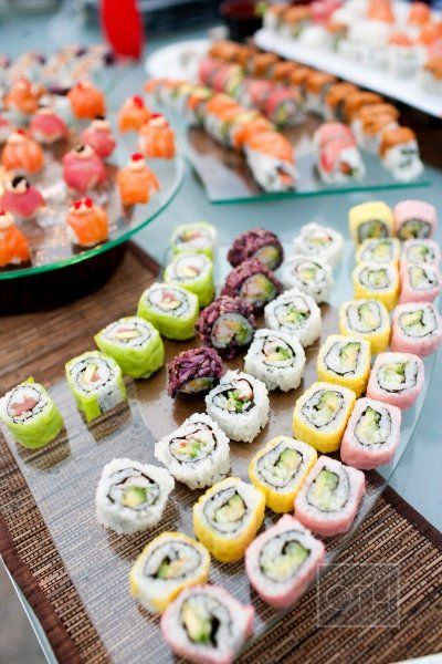 Asian themed wedding? Or maybe your guests are fans of raw fish delicacies... either way, a sushi bar at a wedding reception is a sure way to please.| Ooh, maybe if I get better at sushi-making by then