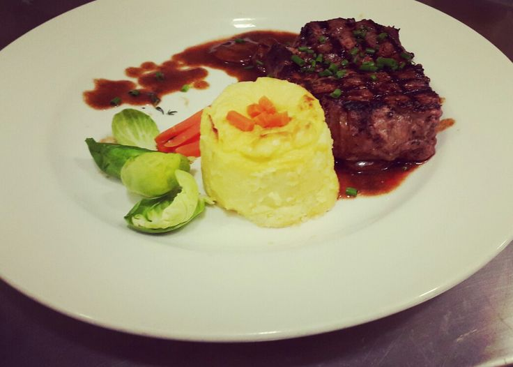 Beef tenderloin with potato mash and mushroom maderia sauce