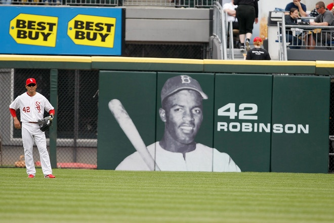 CHICAGO, IL- APRIL 15: Kosuke Fukedome of the Chicago White Sox stands in front of a picture of Jackie Robinson in the outfield during the game against the Detroit Tigers at U.S. Cellular Field on April 15, 2012 in Chicago, Illinois. Both teams wore the number 42 in honor of Jackie Robinson Day. (Photo by Scott Boehm/Getty Images)