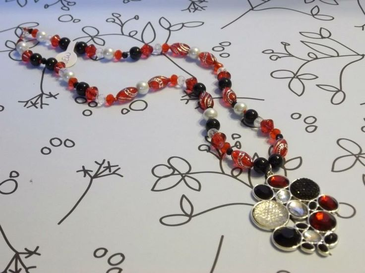 This unique red and black necklace is sure to be a show-stopper