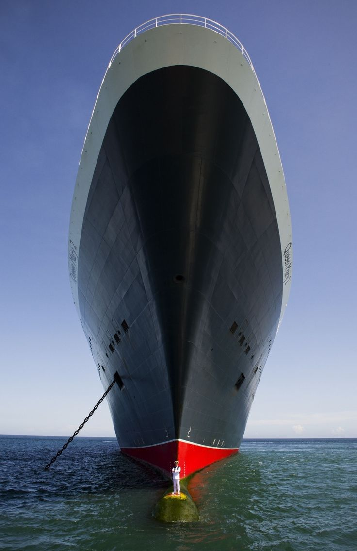 Crazy image of the Queen Mary 2 and it's captain                                                                                                                                                                                 More