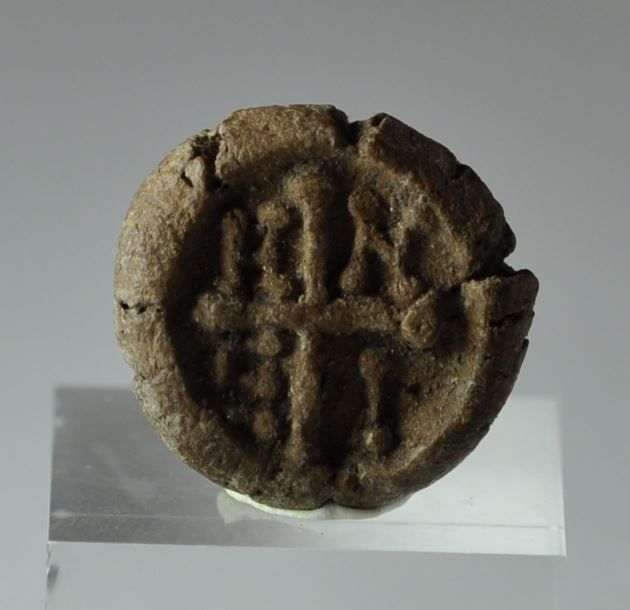 "True cross with a Greek cross with the letters H N E I in the angles, likely reading is hn ei(dos), ""behold the appearance (of the Cross)"", 1.5 cm diameter.  Private collection"