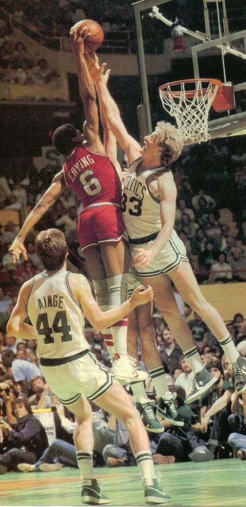 Erving dunks on Bird.  These are the guys who were playing- whose games would be on 66 WNNNBC when I finished swim practice and drove home.