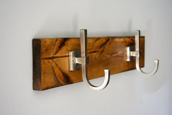 Rustic industrial Ironing board holder with sleek modern hooks