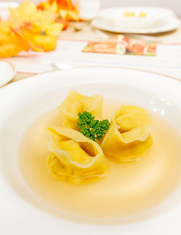 Sandra bakes a party! Tomato consommé served with pumpkin and ricotta tortellini.