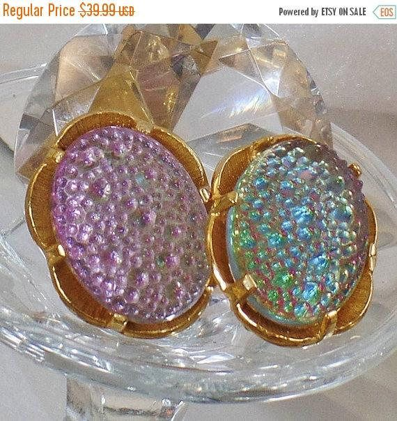 This #vintage Judy Lee earrings are just amazing!  They features a gold plated chunky earring with large oval faux dragon's breath or fire opal cabochons in pink and blue.  ... #ecochic #etsy #jewelry #jewellery