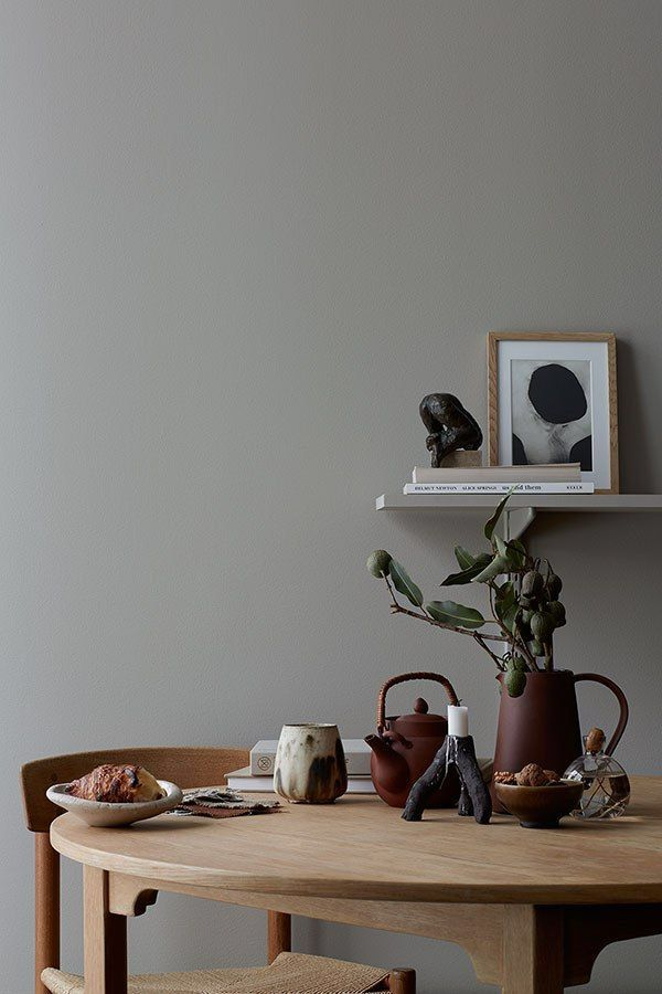 grey wall, wooden dining set, beautiful styling