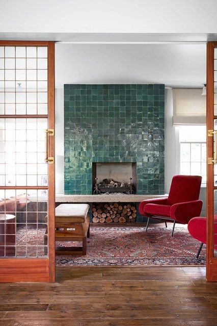Sitting room with tiled bookcase in Living Room Design Ideas. Sitting room with mahogany sliding doors, wooden floor, reclaimed furniture and tired fireplace.