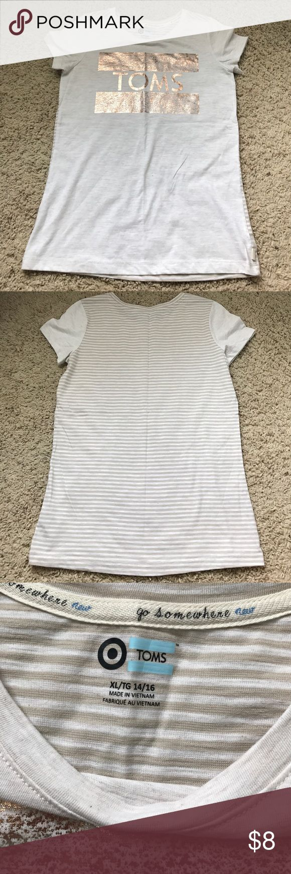 TOMS target gold shirt TOMS target gold shirt- kids XL 14/16 but fits like a women's small (worn once) Toms Tops Tees - Short Sleeve