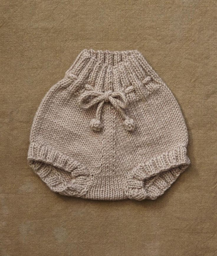 An interesting construction with no seaming makes it ideal for the comfort of small babies. A quick knit completely in the round with a nice high rise in the back. A good excuse to learn short row shaping and Kitchener stitch. Make this in a non-superwash wool and it is an ideal soaker for clo