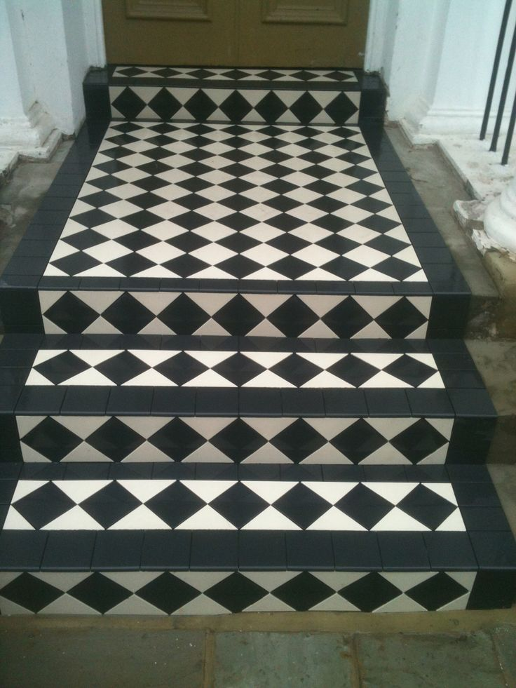 Classic black and white Victorian tiling with steps, a very bold statement to this front door.