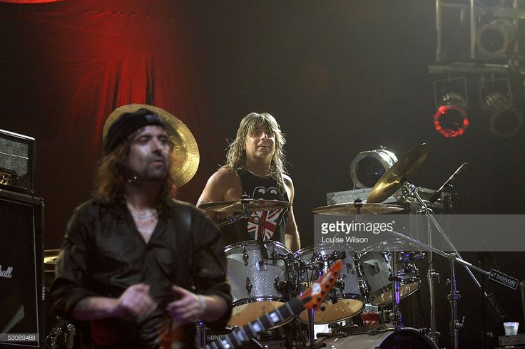 Phil Campbell (L) and Mikkey Dee of Motorhead perform on stage at the Hammersmith Apollo June 16, 2005 in London, England. Motorhead celebrates their 30th anniversary this year with the return of 'The Bomber' onstage and the re-release of the album of the same name.  (Photo by Louise Wilson/Getty Images)