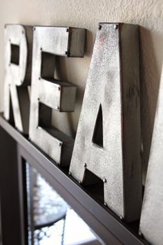 some cardboard letters, spray paint and brads, and voila!  Sweet Verbena: Zinc Letters: Anthropologie Inspired