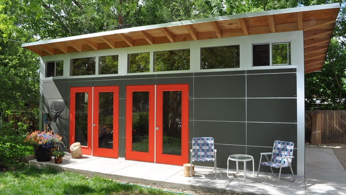 Studio Shed that serves as a garage (entry at right) AND guest house, art studio   Studio Shed | Modern Shed.  I love the look, with the deep grey/black; celestory windows; red doors!  what about exterior stairs to a roof patio?