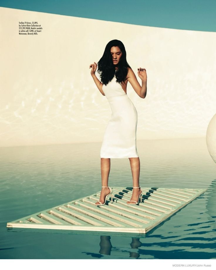 Posing poolside, Olivia Munn wears a little white dress from Calvin Klein Collection