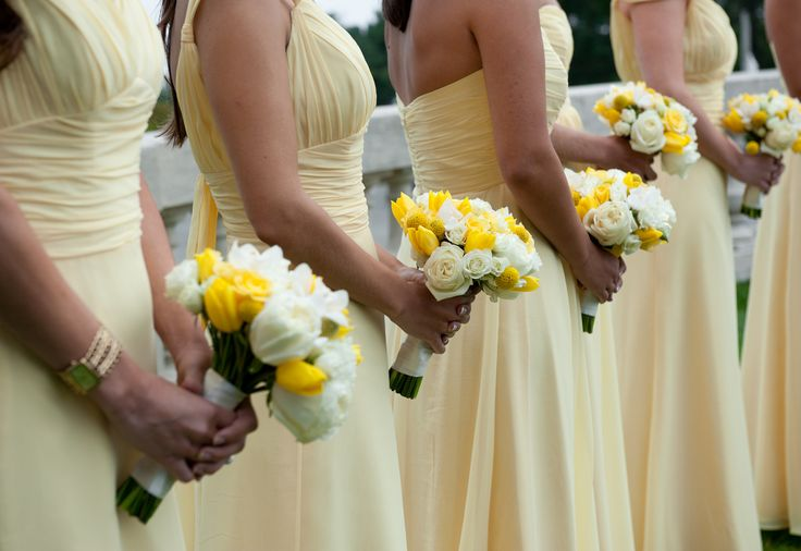 Lovely tulip bridesmaid bouquets with roses and craspedia.