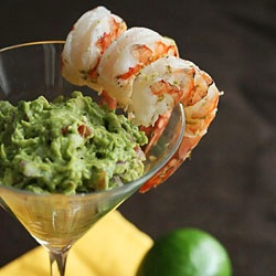 Margarita Shrimp with Grilled Avocado Guacamole: Mexican twist on the classic shrimp cocktail.