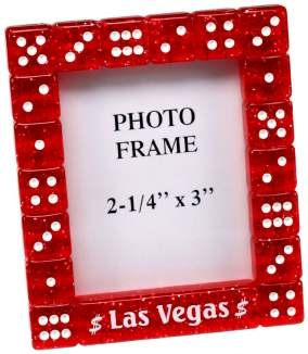 Interesting Idea for a Photo Frame - Las Vegas theme...fore engagement photo on guestbook table.