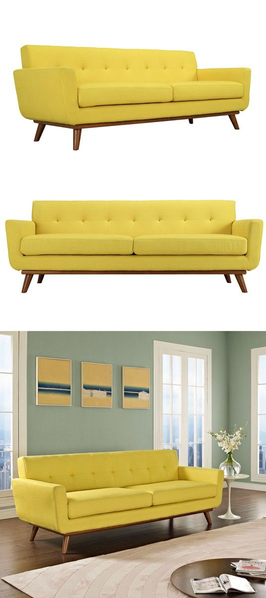Add a jolt of color to your home. Whether it's the living room, den, or bedroom, this sofa makes a statement. Sunny yellow upholstery brightens up any room while sturdy cherry-stained legs add a sophisticated finish. Lemon drop tufts are an added eye-candy treat. The long, soft cushions make a perfect place to lounge alone, or to snuggle up with that special someone.