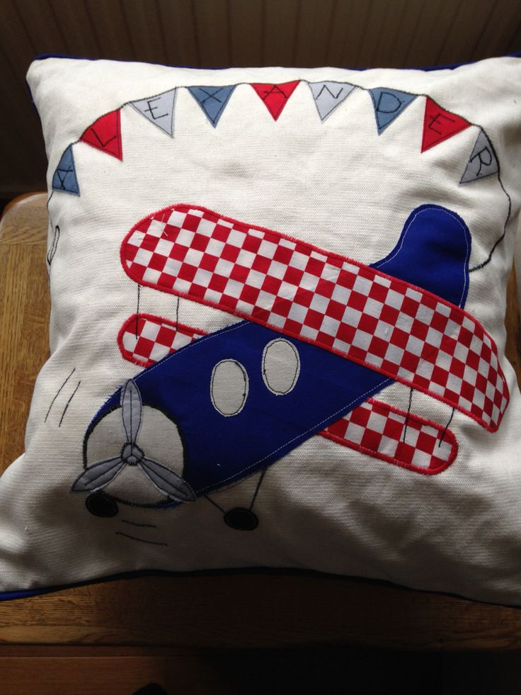 Appliqué aeroplane bunting cushion for a young boy