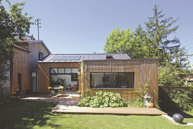 Cuisine salon ou chambre l 39 extension ossature bois se for Extension de maison en bois prix au m2