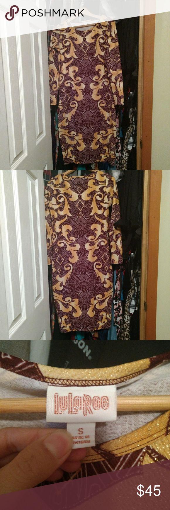 LulaRoe Debbie Worn once!  (Pictured) EUC size Small LulaRoe Elegant Debbie.  It's details hug every curve & give you a brilliant shape!  Gold & sparkly filagree with a brown/burgundy background.  It is stunning! LuLaRoe Dresses Long Sleeve