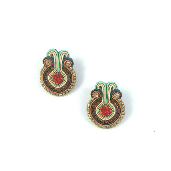Dopodomani definitely has a little vintage flair... we love the Beige & Orange Francesca Earrings, available on our site. Get them here: http://www.jewelbemine.com/collections/dopodomani/products/beige-orange-francesca-earrings