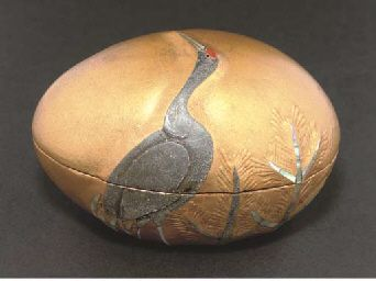 A Japanese lacquer kobako of egg-shaped form, with signature ...