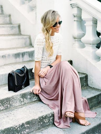 Mary Seng of Happily Grey wears a maxi skirt and a white lace top for a flirty street style look.