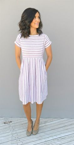 Our chambray stripe pleated dresses are oh so stylish. They have pockets, are knee length, and have a side zipper for easy fitting.